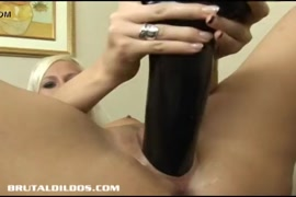 Babe cocks toys her pussy with pink dildo.