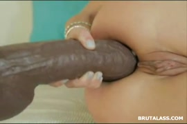 Horny blonde with beautiful ass plays with dildo.