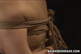 Bondage slave bound by a gagged cock and whipped.