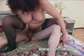 Hairy mommy fucks young boy on bed.