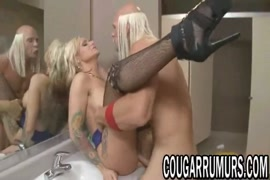 Naughty blonde milf with hairy pussy fingering in bathroom.