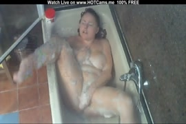 Cute redhead girl shows off in the shower.