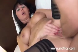 Sexy brunette milf with nice tits plays with her pussy with a vibrator.