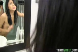 Shemale playing with her huge cock in a bathroom.