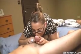 Busty milf sucks and fucks her son's dick while he films.
