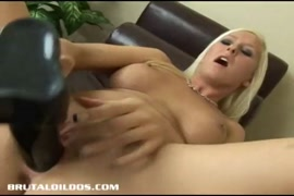 Hot blonde babe with pierced tits rides on dildo.