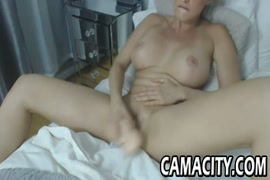 Teen with big tits fucks herself with a dildo.