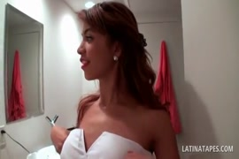 Huge boobed latina in a red sexy dress.