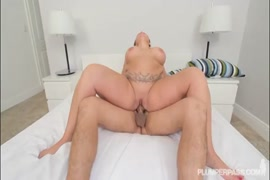 Big black cock cums on a redheaded girl in the shower.