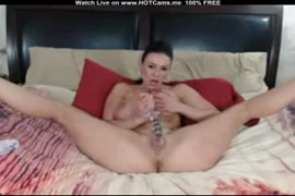 Big tits milf masturbates with dildo and rubs her hairy pussy.