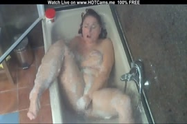 Sexy redhead in the shower.