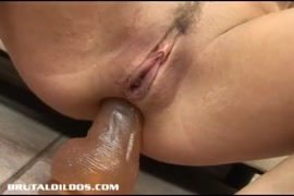 Young babe in pantyhose sucks dildo.